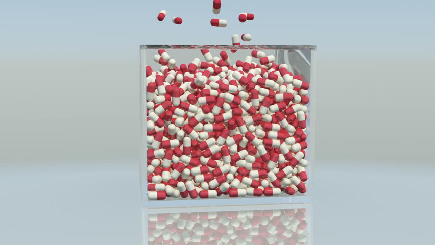 Large number of pills falling down in a box. | Shutterstock HD Video #5087219
