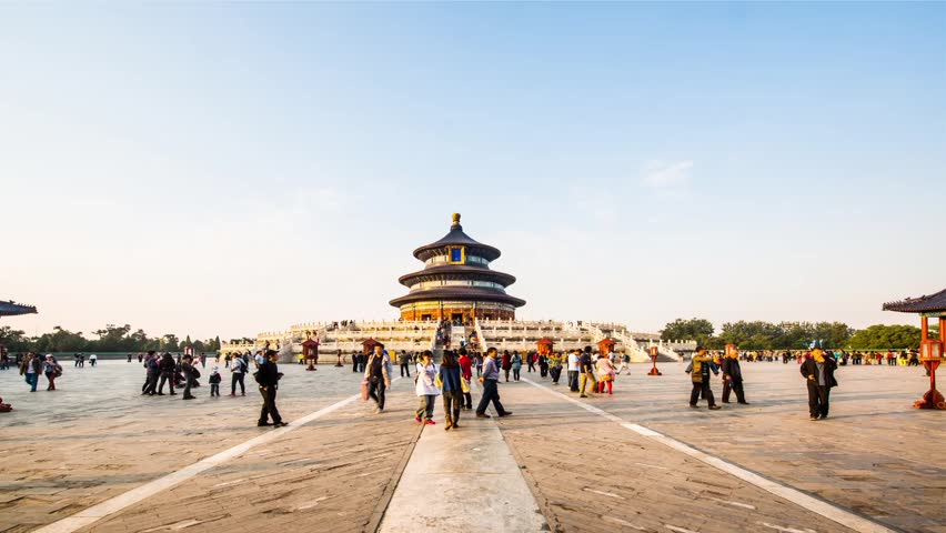 BEIJING, CHINA - CIRCA OCTOBER 2013: From day to dusk, the visitors in the Temple of Heaven, Beijing, China