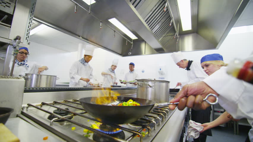 Hd00:11Professional Chef In A Commercial Kitchen Cooking Flambe Style. In  Slow Motion.