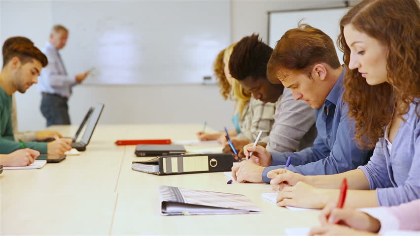 college classroom whiteboard. students writing in classroom with teacher on whiteboard full hd stock footage video 5119604 shutterstock college 1