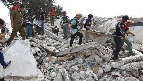 NAZARETH ILLIT, ISRAEL - NOVEMBER 27: Volunteers from minority villages rescue rocket attack casualties during simulation drill in Nazareth Illit, Israel, November 27, 2013