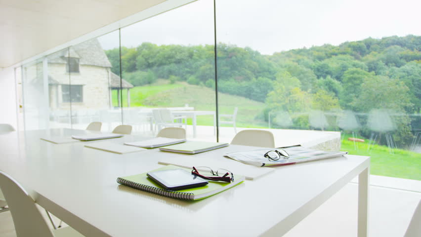 Abandoned meeting room in contemporary glass building in a natural setting