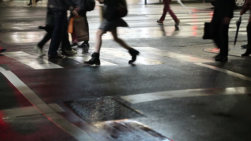 People crossing street. Crowded crosswalk. City life