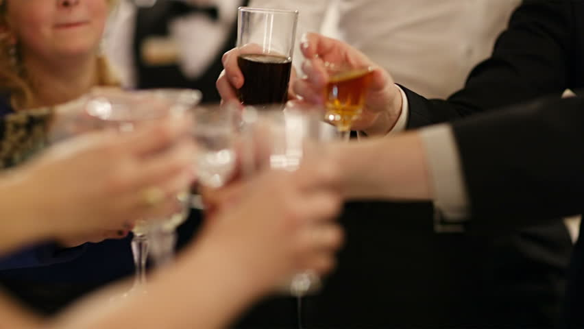 Group of people toasting at a celebration clinking their glasses together in congratulations , close up view of their hands | Shutterstock HD Video #5189816