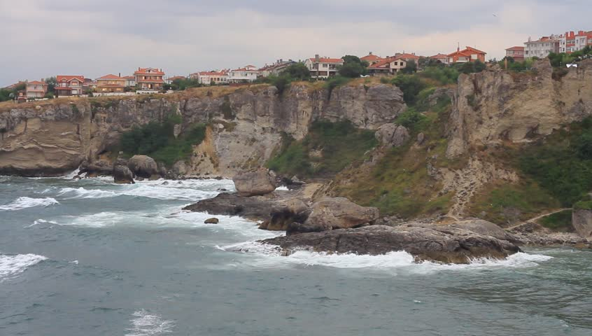 Waves crash upon the shores of a rocky cliff face in Sile. Rocky shore of northern city.  #5226017