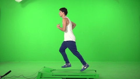 Man runing on a green screen backround, in slow motion