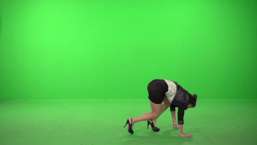 cd74b397902 Dancer dressed as business woman falling on a green screen backround, in  slow motion