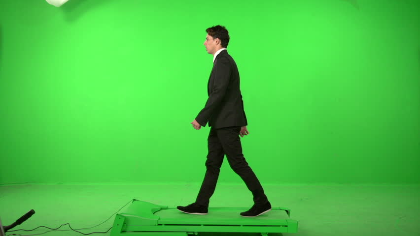 Business man walking on a green screen backround | Shutterstock HD Video #5226254