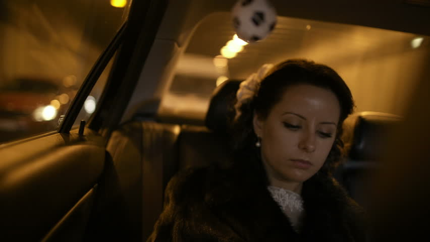 Beautiful bride in fur coat traveling by car. Time before wedding. | Shutterstock HD Video #5247467