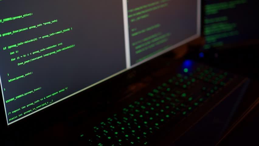Hacker's hands typing on computer