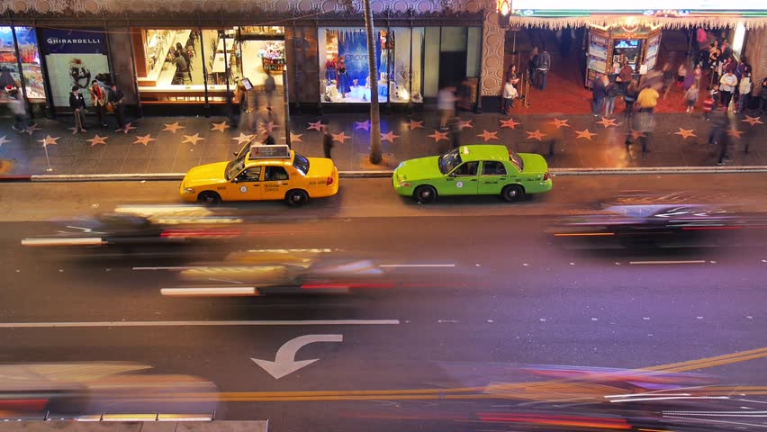 LOS ANGELES - DECEMBER 13:  (Timelapse View) Night traffic on Hollywood Boulevard on December 13, 2013 in Los Angeles, California. Hollywood is an international tourist attraction in LA. | Shutterstock HD Video #5250464