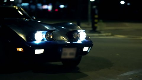 Corvette C3 driving through the city
