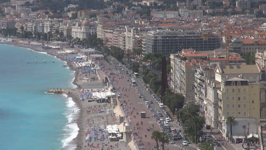 NICE, FRANCE - SEPTEMBER 9, 2013, Aerial view of Nice city with traffic street and  Promenade des Anglais boulevard by day