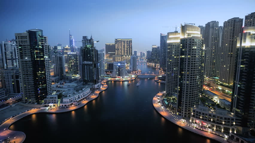 Dubai Marina time lapse, day to night transition overlooking the area's skyscrapers and waterways. Dubai, United Arab Emirates | Shutterstock HD Video #5299409