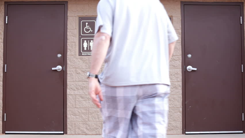 Man going in to restroom