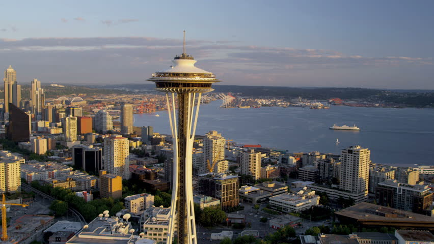 Seattle - July 2013: Aerial view at sunset downtown Seattle skyscrapers Space Needle Port of Seattle Washington State, Pacific Northwest, USA, RED EPIC, 4K, UHD, Ultra HD resolution