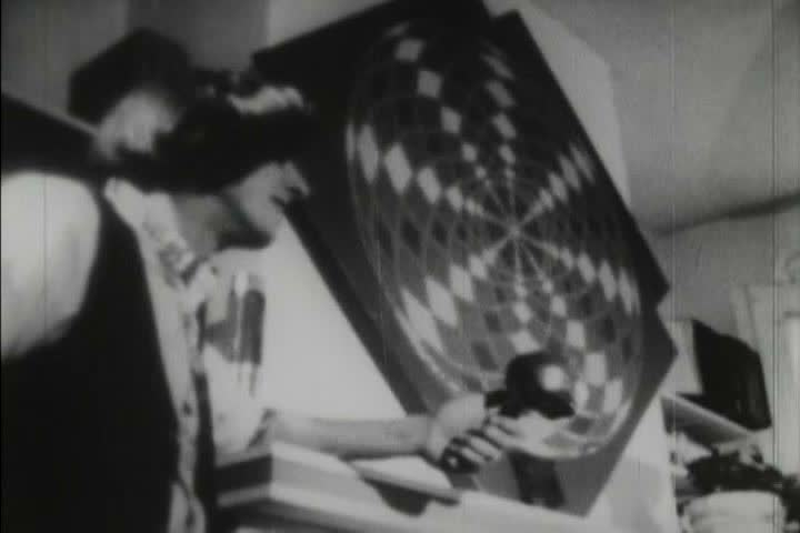 Black and white footage of hippy concerts, drum circles, and lifestyle during the 1970s