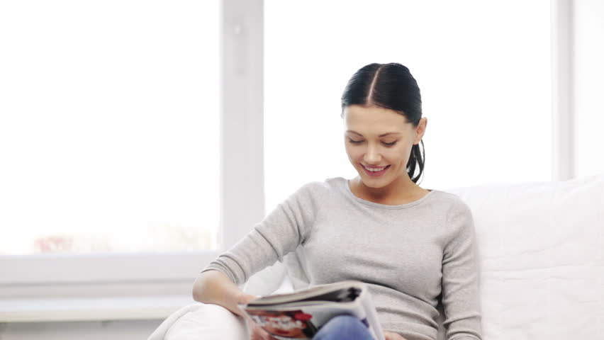homa and leasure concept - smiling woman reading magazine at home