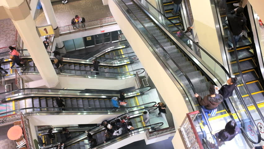 PROVIDENCE, RI - DECEMBER 26: (Timelapse) People on escalators at Providence Place Mall on Dec 26, 2013 in Providence, RI. Providence Place is a 1.3 million-square-foot regional mall opened in 1999.