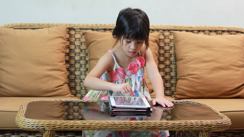HD Dolly: Little Girl Plays With A Smartphone Stock