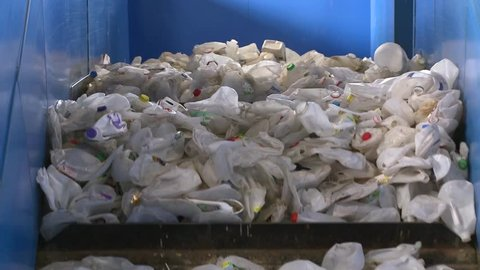 Close up of recyclables on a cleated conveyor (3 of 8)