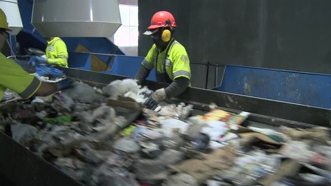 Trash workers weeding through recyclables (4 of 10)