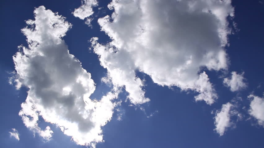 Spectacular clouds in the blue sky with sun, time lapse