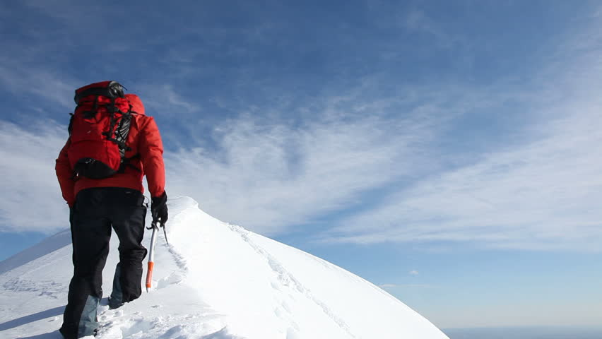 Mountaineer reaches the summit of a snowy ridge and expresses his joy - low angle view - HD1080p Canon 5DMkII | Shutterstock HD Video #5365508