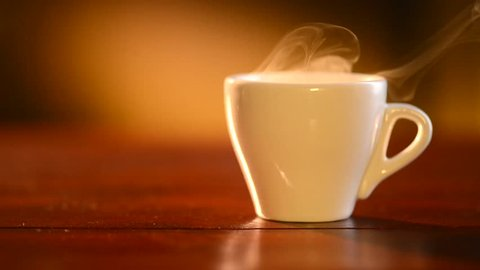Cup of Hot Coffee Espresso. Coffee or Tea. Brown Cup of hot beverage with Steam. Espresso Coffee closeup. HD video Footage
