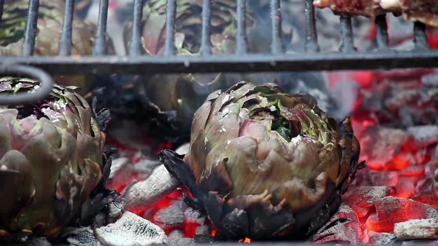 Video clip of artichokes grilling inside the burning coal.