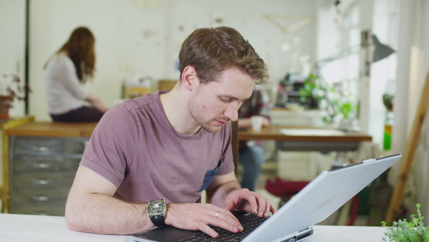 Portrait of a happy young male student, working in a shared study space | Shutterstock HD Video #5395664