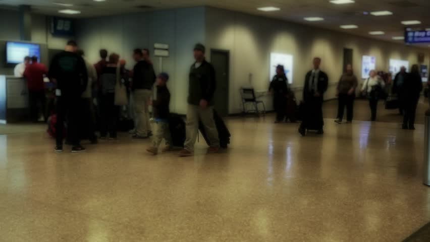 People in a busy airport terminal after a snow storm | Shutterstock HD Video #5398394