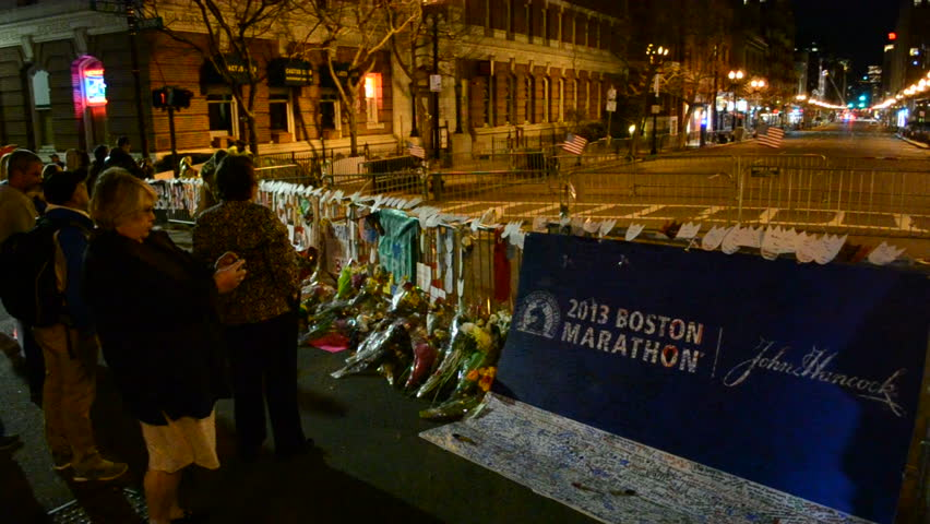 BOSTON-APR 18: People poured over the memorial set up on Boylston Street in Boston,USA on April 18,2013. More 23300 runners take part in Marathon. 3 people killed, over 100s injured on April 15,2013.
