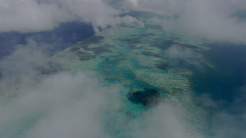 Sandbar Flyover. Aerial shot of the skies above a large sandbar in blue ocean. #5422862
