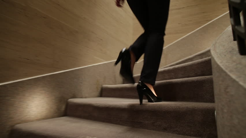 girl with heels on the stairs going up