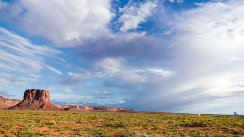 Summer skies at Monument Valley facing south with monsoon cloud formations in time lapse