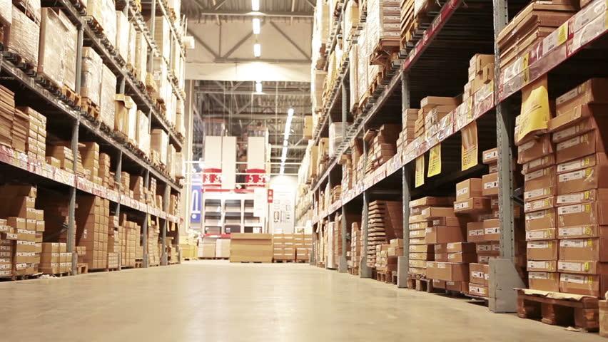 Young woman walking between shelves with goods in shop | Shutterstock HD Video #5483204