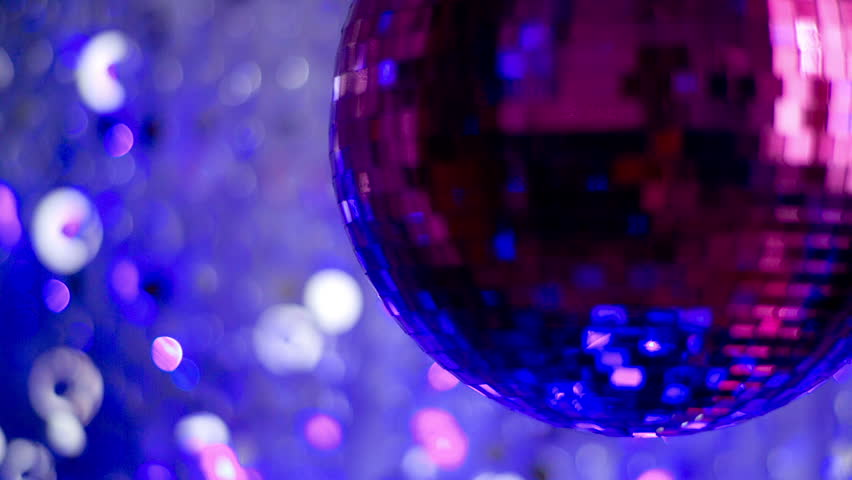 Funky pink mirror ball spinning with patterns of light. useful for vj loops, events, clubs and parties