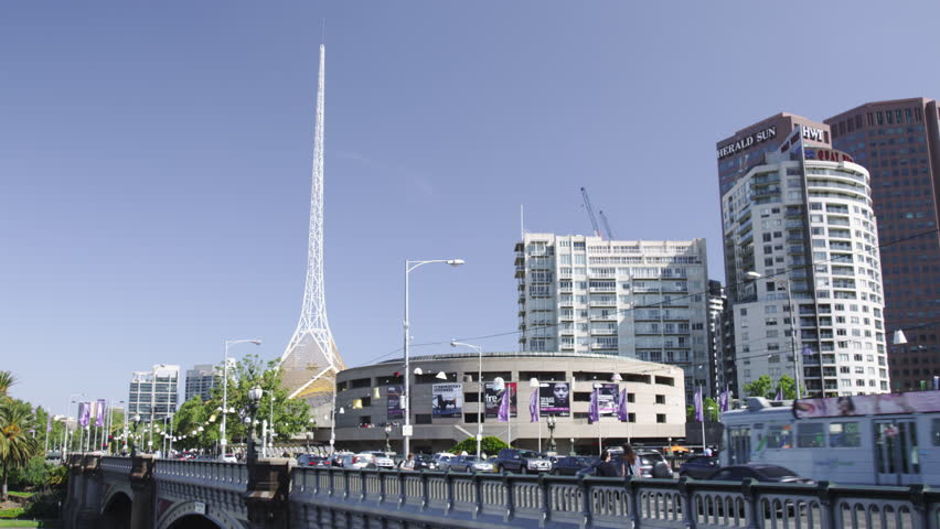 MELBOURNE, AUSTRALIA - OCT 2009: Trams on Princess Bridge with The Arts Center and the Spire | Shutterstock HD Video #5503604