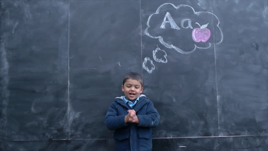 Little Multi-Ethnic Boy Recites His ABC's Under Chalkboard Thought Cloud of