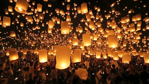 SANSAI, CHIANGMAI, THAILAND - NOV 16: Thousand of sky lanterns release at Loi Krathong celebration during Yee Peng Festival in Chiangmai Mae Jo University, Thailand on November 16, 2013