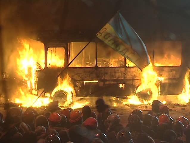 KIEV - JAN 20 2014:20. January. Ukraine in 2014. Kiev.Burning bus, protesters clash with police