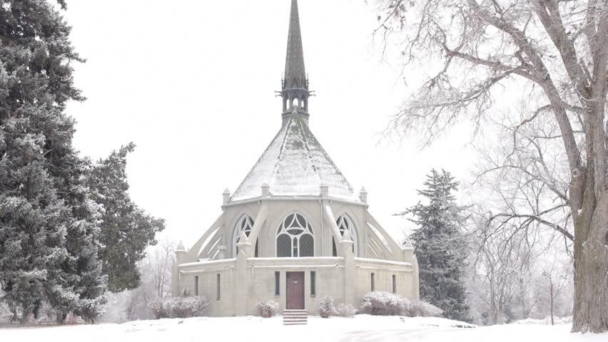 Beautiful chapel in a winter scene. HD 1080p slow zoom out.
