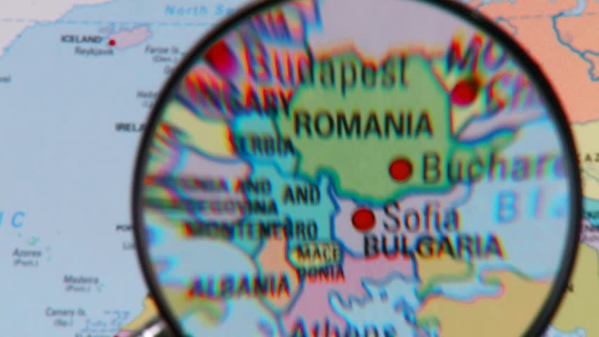Magnifying glass showing the countries of the world