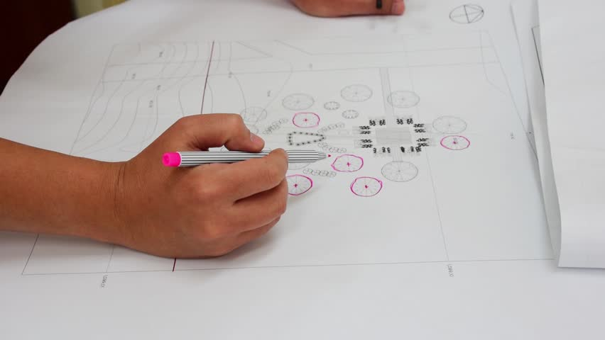 An asian architect is checking his architecture plan blueprint of a professional asian architect is circling a tree symbol location to confirm his architecture blueprint plan malvernweather Image collections