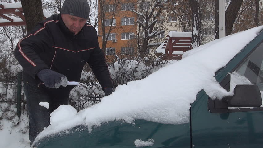 Man, Driver Remove, Cleaning Snow by Car in Parking Lot on Blizzard on a Snowing Day in Winter | Shutterstock HD Video #5545364