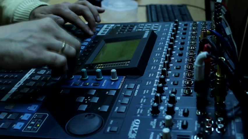 Man for the television audio mixer board  works | Shutterstock HD Video #5579444