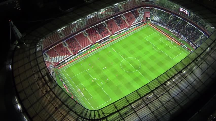 MOSCOW - OCT 21, 2013: Soccer teams play on field during match of UEFA Champions League on Lokomotiv football stadium at night