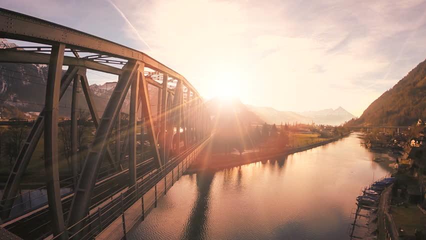 epic flying view. bridge road. street train traffic transportation. lake river pond. panorama landscape. sunset sky #5597762