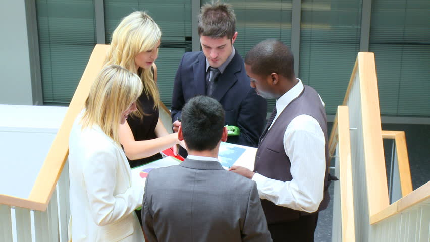 Business team discussing in corridor footage   Shutterstock HD Video #559864